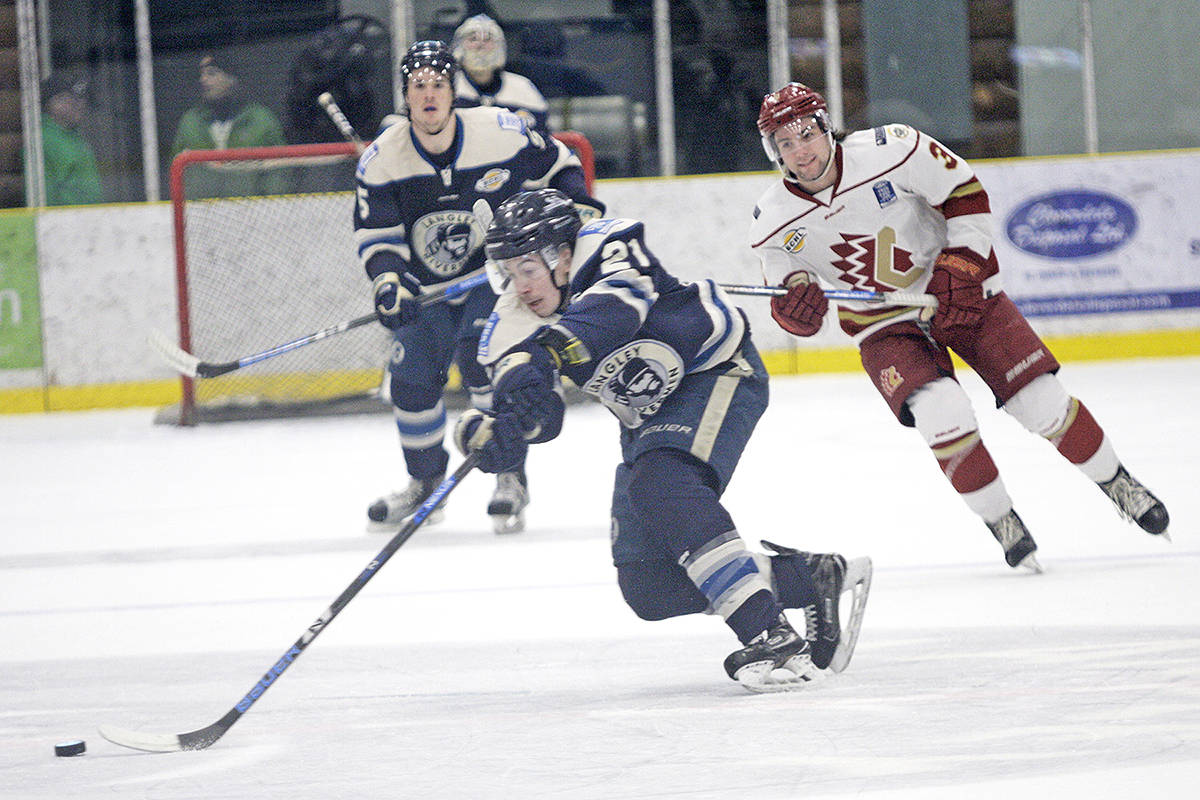 Rivermen forward Nicholas Ponak stretches for the puck while Chiefs defenceman Jake Gresh and Rivermen defenceman Jordan Dawson follow. Dan Ferguson Langley Times