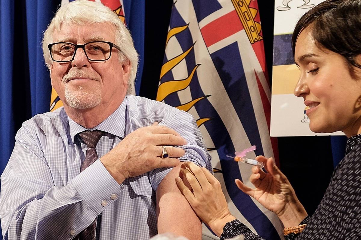 Provincial Health Officer Dr. Perry Kendall gets his annual flu shot. Influenza vaccines are still available. (Tom Fletcher/Black Press)
