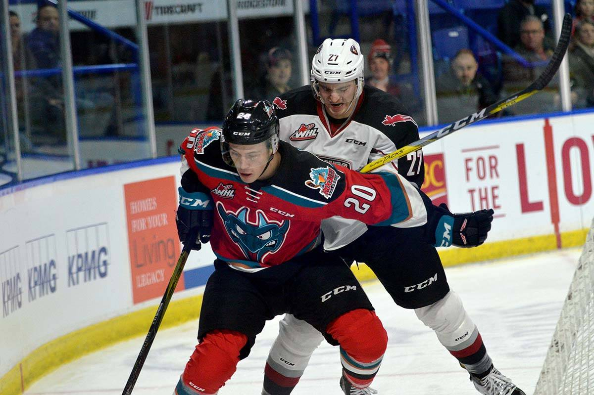 Kelowna Rockets vs Vancouver Giants, WHL at Langley Events Centre, Jan. 13 Kelowna's Connor Bruggen-Cate holds off Vancouver's Brennan Riddle. Gary Ahuja Langley Times