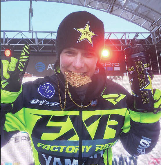 Brock Hoyer celebrates his 2017 X Games gold medal win in snow bike. (Photo submitted)