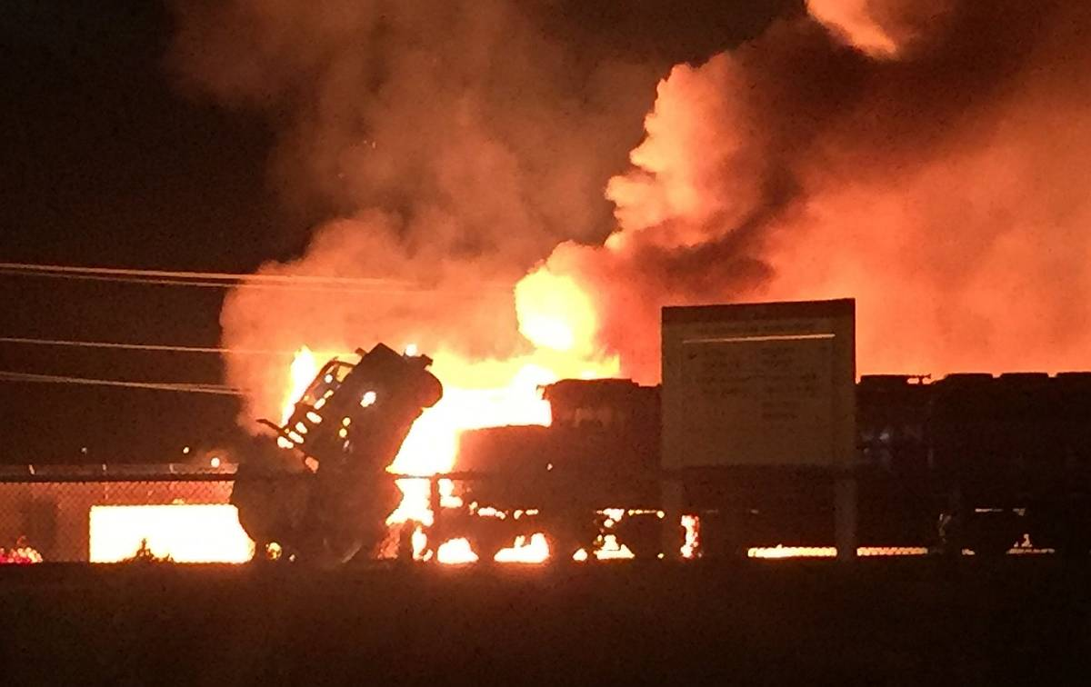 A massive fire broke out at the CP Rail yard in Port Coquitlam Monday night after a train collided with a truck that was carrying ethanol. photo courtesy @belleamanda on Twitter