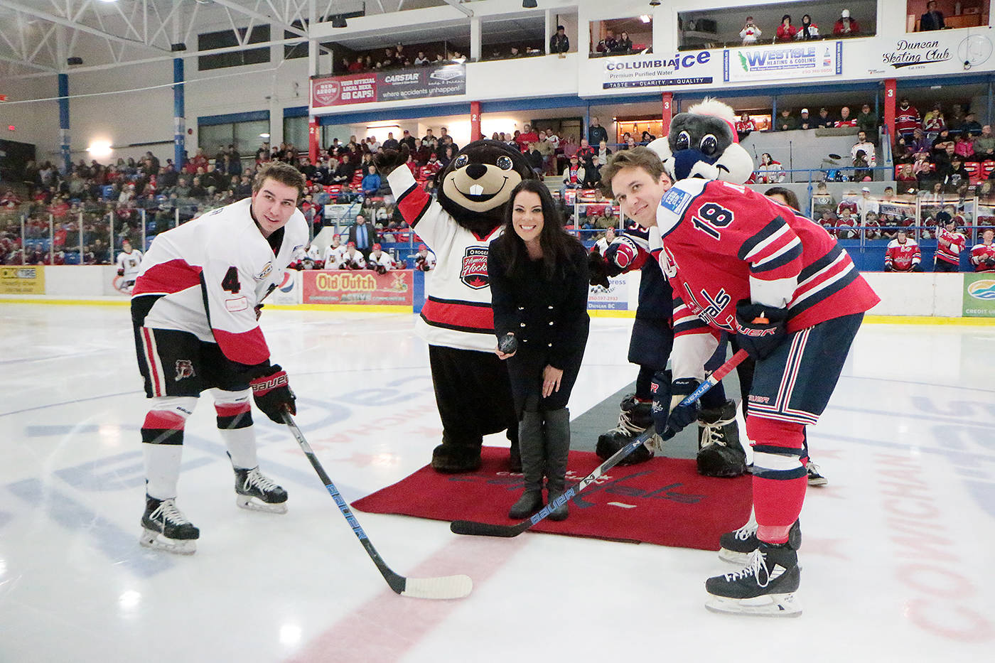 Rogers Hometown Hockey co-host Tara Slone drops the puck for a ceremonial faceoff between Cowichan Valley Capitals captain Troy MacTavish (right) and Alberni Valley Bulldogs captain Mitch Oliver prior to Saturday night's BCHL tilt, one of many highlights of the festival's visit to the Cowichan Valley last weekend. (Kevin Rothbauer/Citizen)                                Rogers Hometown Hockey co-host Tara Slone drops the puck for a ceremonial faceoff between Cowichan Valley Capitals captain Troy MacTavish (right) and Alberni Valley Bulldogs captain Mitch Oliver prior to Saturday night's BCHL tilt. (Kevin Rothbauer/Citizen)                                Rogers Hometown Hockey co-host Tara Slone drops the puck for a ceremonial faceoff between Cowichan Valley Capitals captain Troy MacTavish (right) and Alberni Valley Bulldogs captain Mitch Oliver prior to Saturday night's BCHL tilt. (Kevin Rothbauer/Citizen)