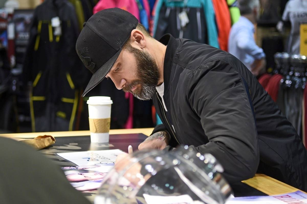 Dallas Smith signed autographs while visiting Sea to Sky Motorsports in Murrayville on Jan. 31. Miranda Gathercole Langley Times