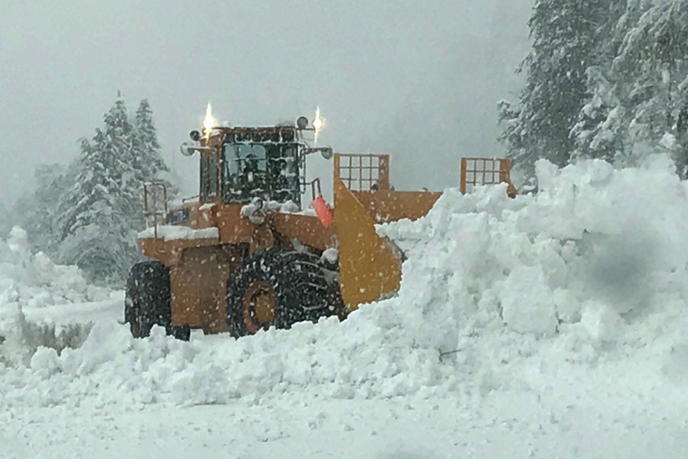 Crews clear the highway after avalanche control at Three Valley Gap on Feb. 2. Avalanche control is planned for Hwy. 1 near the B.C./Alta. border this morning. (Twitter/EmconD)