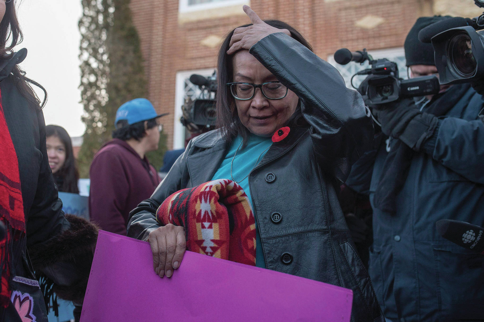 Debbie Baptiste, the mother of Colten Boushie, leaves during a lunch recess on the day of closing arguments in the trial of Gerald Stanley, the farmer accused of killing 22-year-old Indigenous man Colten Boushie, in Battleford, Sask. on Thursday, February 8, 2018. THE CANADIAN PRESS/Liam Richards