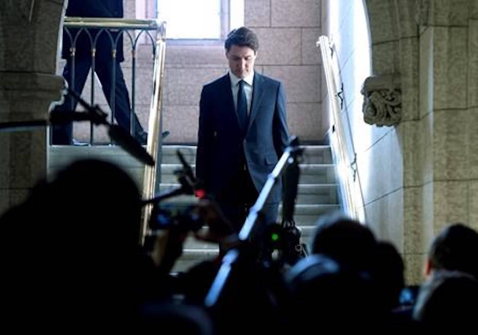 Prime Minister Justin Trudeau walks down the stairs to Question Period into the House of Commons on Parliament Hill in Ottawa on Monday, Feb. 12, 2018. THE CANADIAN PRESS/Justin Tang