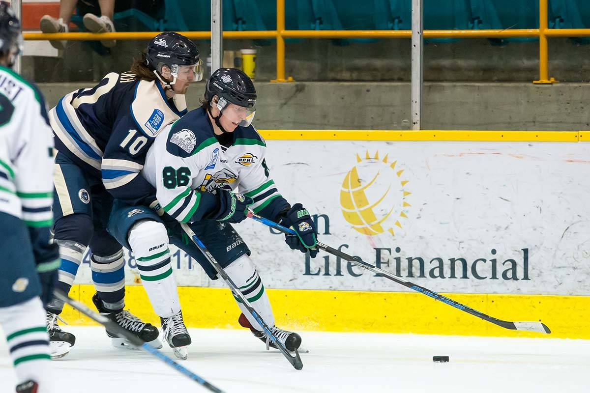 Langley Rivermen's Sean Gulka checks Surrey Eagles' Chase Danol during BCHL action earlier this season. Gulka and the Rivermen scored a huge 7-6 win when the teams met on Saturday at the South Surrey Arena. Garrett James photo