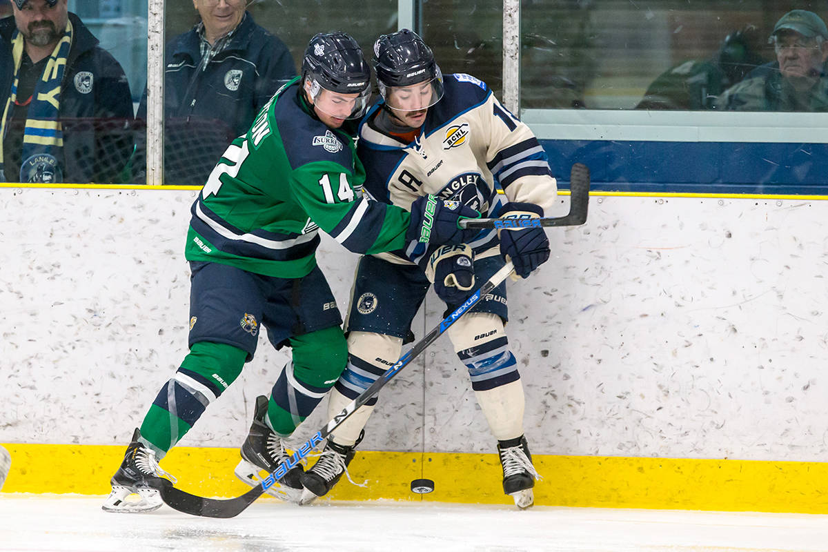 Surrey Eagles defenceman Owen Norton (left) battles for the puck along the boards with Langley's Trevor St. Jean during BCHL action earlier this season. The Rivermen scored a huge 7-6 victory when the teams met on Saturday night. Garrett James photo