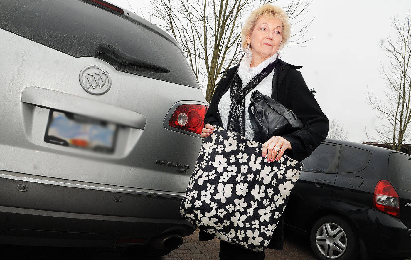 Longtime Langley resident Bonnie Mitten stood next to her SUV on Thursday afternoon, Feb. 15. Mitten was unloading groceries at her SUV a couple of weeks ago when a thief stole her bag from her shoulder. A handful of Good Samaritans rushed to help her recover her stolen items. Troy Landreville Langley Times