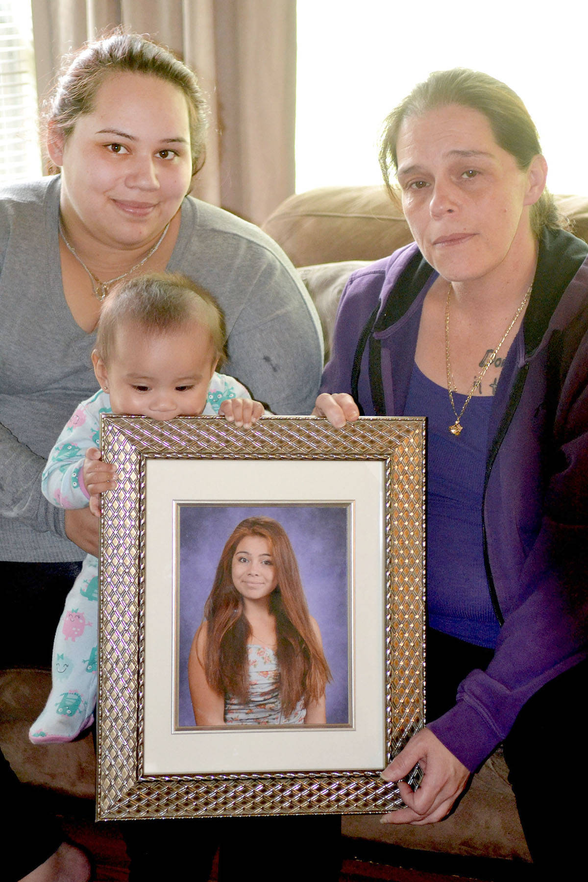 Grieving mom Angela Ramos, (right) holds a picture of her daughter Lidia who died in a car crash on a logging road in Mission on March 5, 2016. A 23-year-old man has been charged with dangerous driving causing bodily harm. Monique Tamminga Langley Times