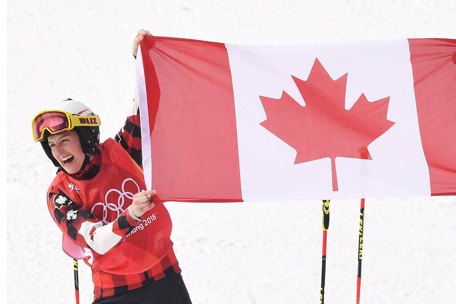 Gold medalist Kelsey Serwa, left, and silver medalist Brittany Phelan both of Canada celebrate following the women's ski cross final at the Phoenix Snow Park at the 2018 Winter Olympic Games in Pyeongchang, South Korea, Friday, Feb. 23, 2018. THE CANADIAN PRESS/Jonathan Hayward