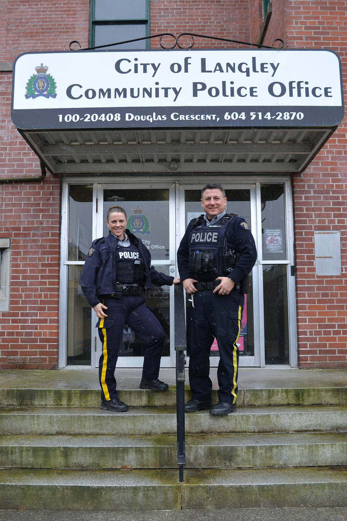 After two years of working in downtown Langley, RCMP Cpl. Steve McKeddie is handing over his duties as Langley City Community Liaison Officer to Const. Lisa Cormier who will be based out of the City CPO. Monique Tamminga Langley Times