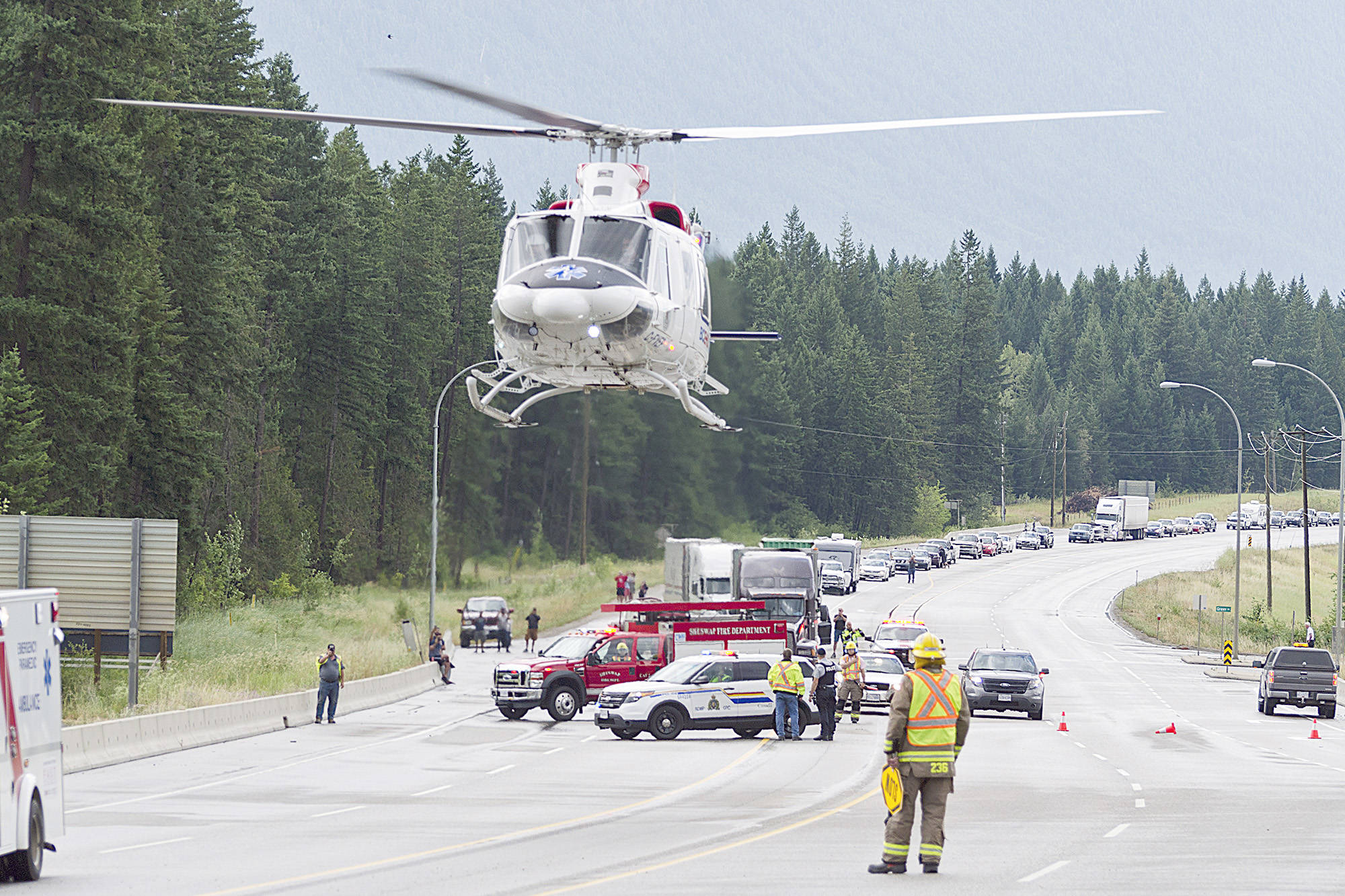 FILE — An air ambulance helicopter lifts off with a patient following a multiple-vehicle collision on Highway 1 near Shuswap Lake Estates on Thursday, July 20. (Lachlan Labere/Black Press)
