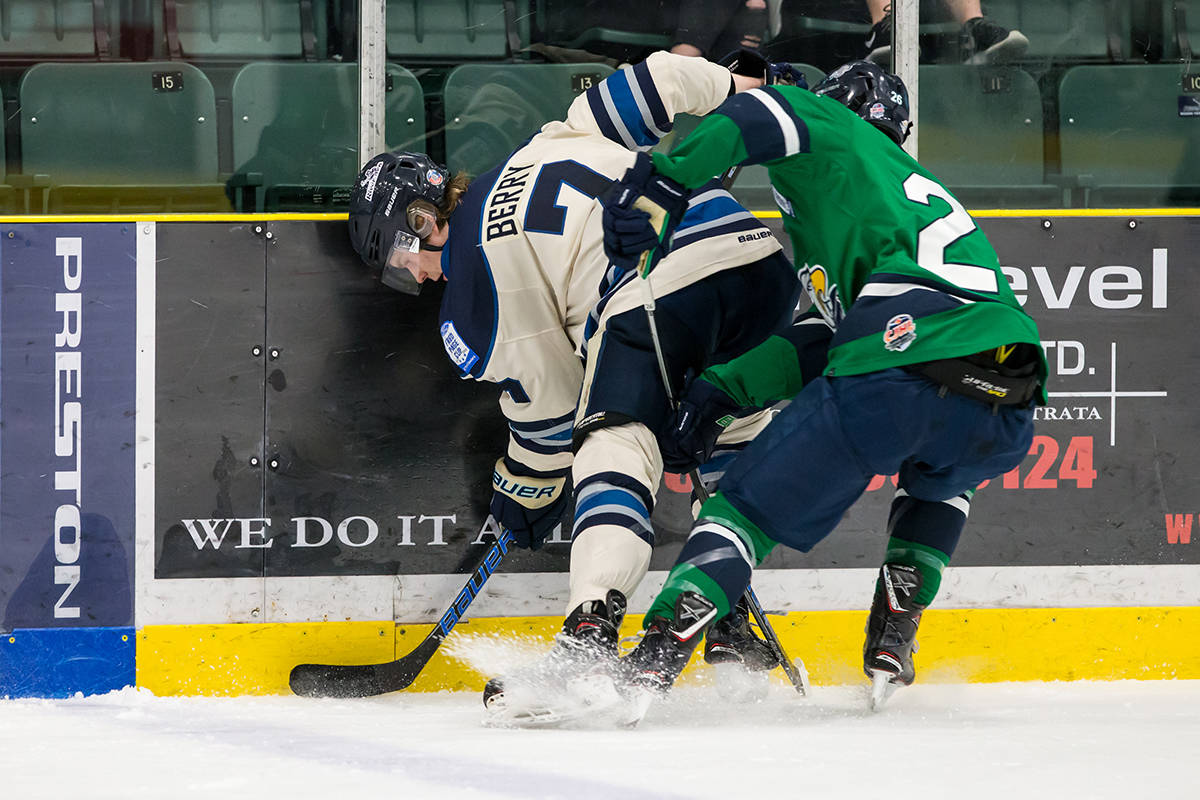 Langley Rivermen's Spencer Berry and Surrey's Gabriel Parent during game one of the teams' best-of-seven playoff series at the George Preston Recreation Centre. Garrett James photo