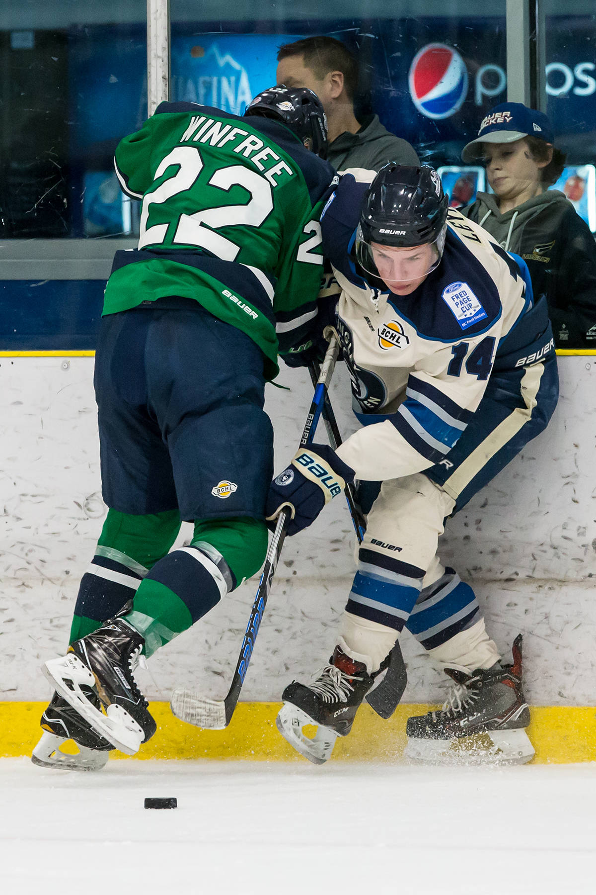Langley Rivermen's Ethan Leyh and Surrey Eagles' Perry Winfree during game one of the teams' best-of-seven playoff series at the George Preston Recreation Centre. Garrett James photo