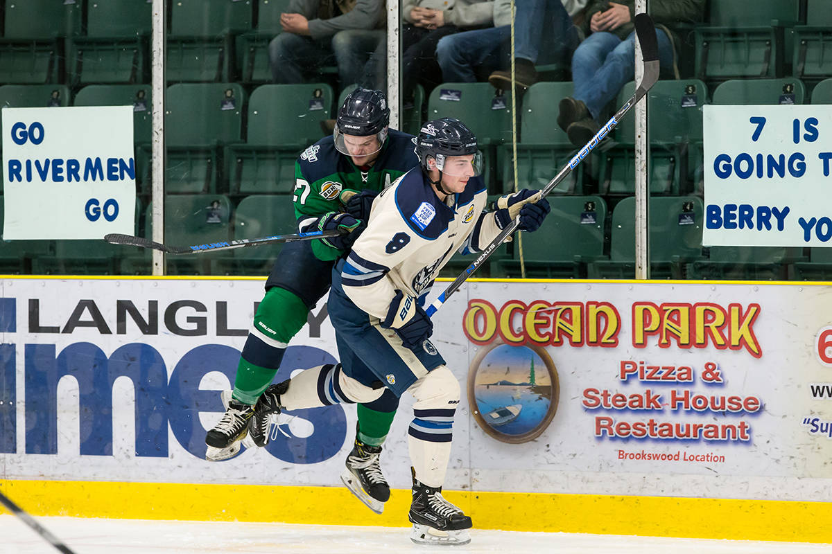 Langley Rivermen's Colin Bernard and Surrey Eagles' John Wesley during game one of the teams' best-of-seven playoff series at the George Preston Recreation Centre. Garrett James photo