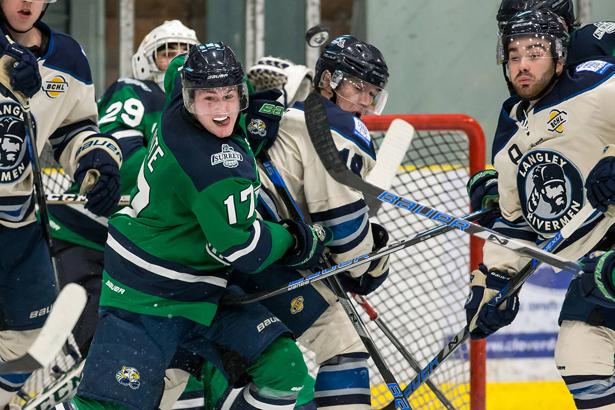 Langley Rivermen's Eric Butte and Surrey Eagles' Aaron White during game one of the teams' best-of-seven playoff series at the George Preston Recreation Centre. Garrett James photo