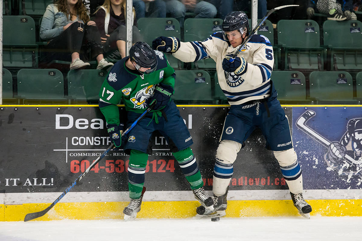 Langley Rivermen's Jordan Dawson and Surrey Eagles' Aaron White during game one of the teams' best-of-seven playoff series at the George Preston Recreation Centre. Garrett James photo