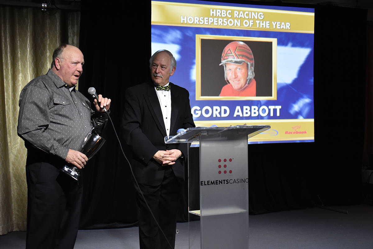 Gord Abbott accepts the award for Horseperson of the Year. The evening's host, Dan Jukich, looks on.(Samantha Anderson)