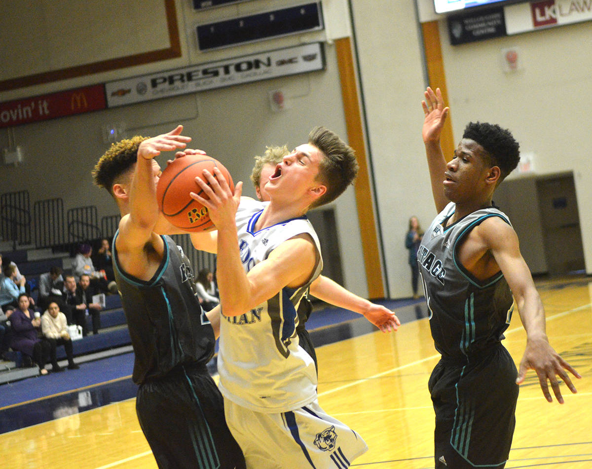 Credo Christian's Will Dykstra is fouled on his way to the hoop during the BC boys 1A semifinals on Friday at the Langley Events Centre. The top-seed Kodiaks lost 67-50 to the No. 4 Heritage Christian Saints. Gary Ahuja Black Press