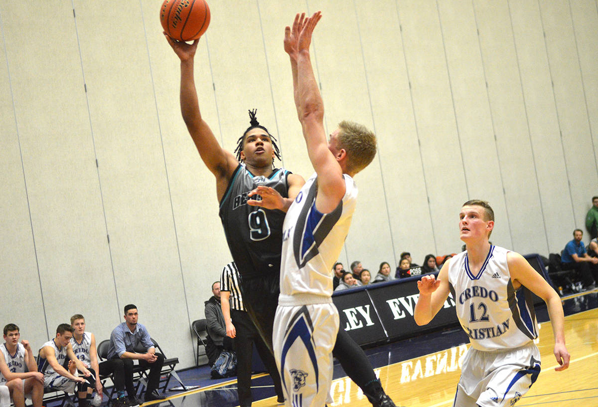 Heritage Christian's Isaiah Akurienne goes up for the shot against Credo Christian during the BC boys 1A semifinals. Gary Ahuja Black Press