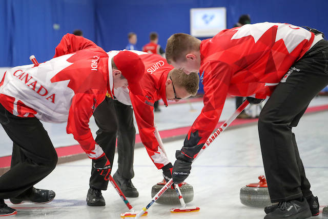 Skip Tyler Tardi lead Zachary Curtis and second Jordan Tardi bring a rock into the house during the gold medal game at the 2018 world junior curling championships in Aberdeen, Scotland. Richard Gray World Curling Federation photo