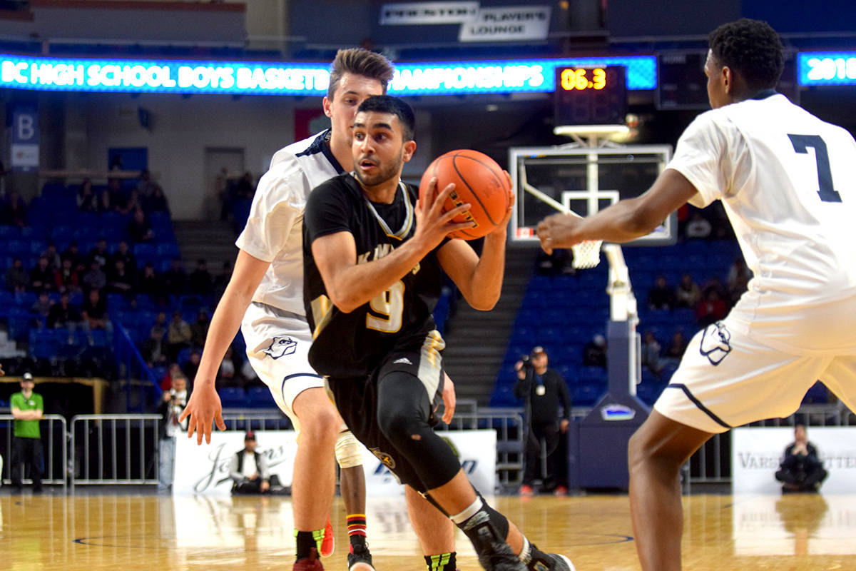 Nick Sarai of the Titans drives to the hoop during the 3A title game on Saturday. (Ben Lypka/Black Press)