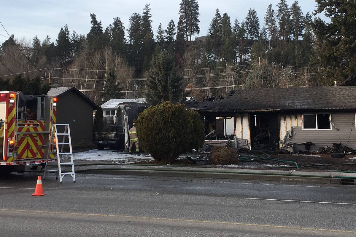 A Kelowna home was razed by a fire that burned throughout the night. (IMAGE CREDIT: KATHY MICHAELS)