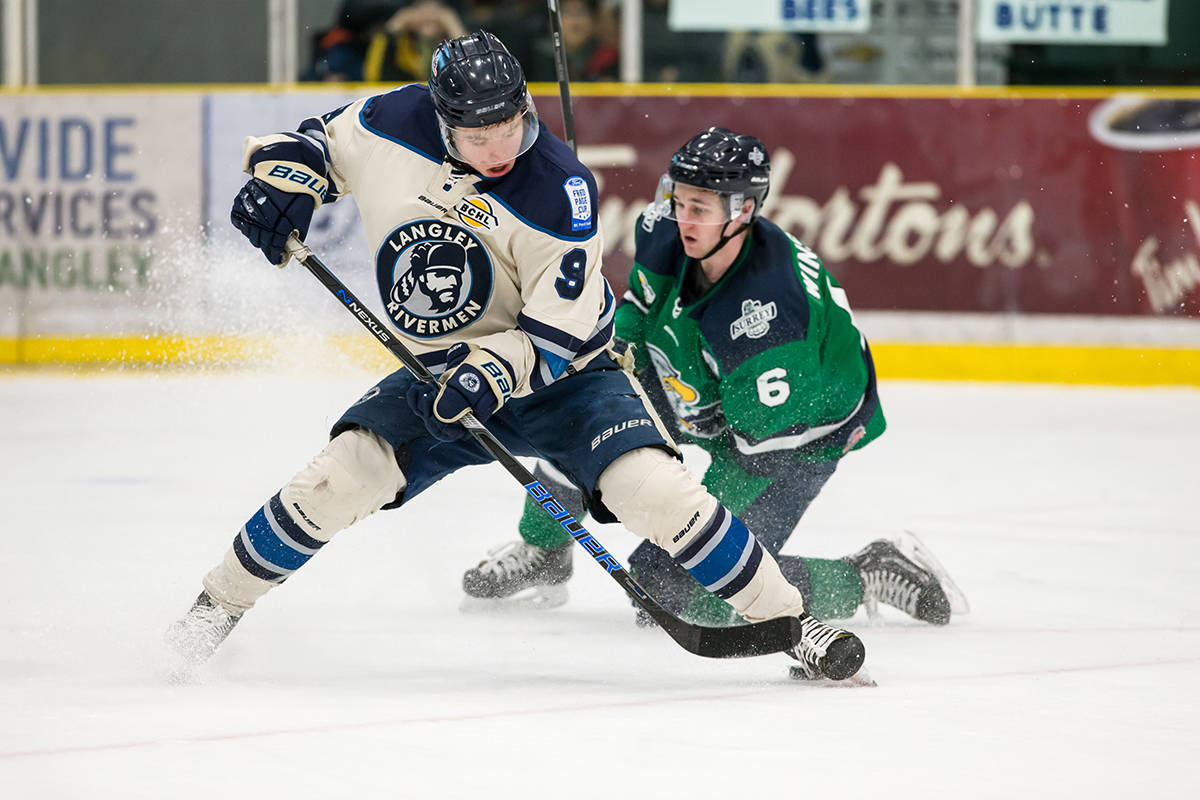 Langley Rivermen's Angus Crookshank and Surrey Eagles' Brendan Winslow during game one of the teams' best-of-seven playoff series at the George Preston Recreation Centre. The Eagles won in six games. Garrett James photo