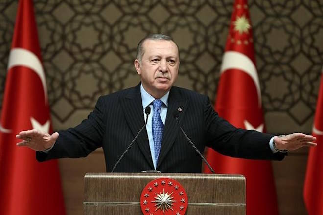 Turkey's President Recep Tayyip Erdogan, gestures as he delivers a speech during a rally in Ankara, Turkey, Wednesday, March 14, 2018. Erdogan expressed hope the Syrian town of Afrin will be encircled by its forces by Wednesday evening, after launching its assault on the Afrin enclave on Jan. 20 to drive out Syrian Kurdish forces. (Kayhan Ozer/Pool Photo via AP)