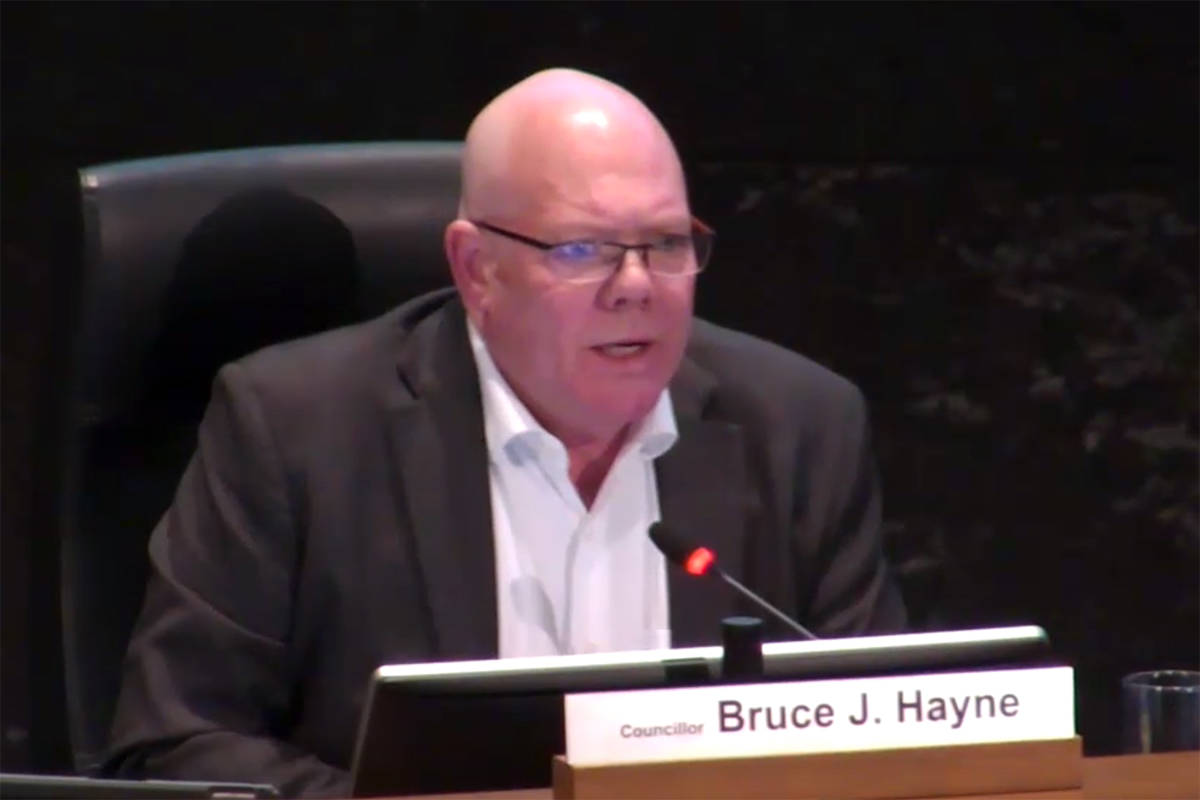 Counc. Bruce Hayne proposes a second survey be done for area opinions on the Cloverdale Slope rezoning proposal. (Surrey Council Meeting Live Broadcast / surrey.ca)