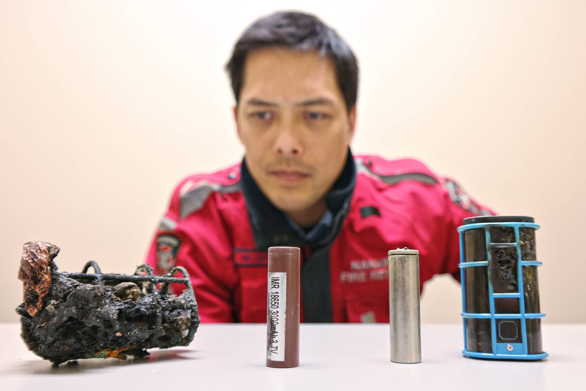 Alan Millbank, Nanaimo Fire Rescue fire prevention officer, shows off the e-cigarette unit, left, that started a fire in a home and displaced a family of four Monday night, along side another unit and batteries from the same model made by the same manufacturer that have also overheated and is warning the units could start more and potentially deadly blazes. (CHRIS BUSH/The News Bulletin)