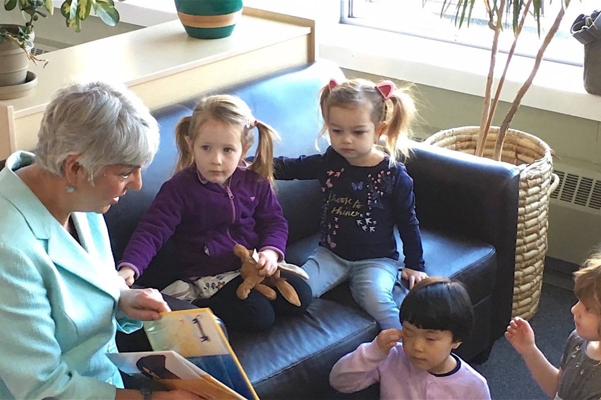 B.C. Finance Minister Carole James visits a Victoria daycare on the eve of her first budget, allocating $1 billion over three years to expand child care, Feb. 19, 2018. (Tom Fletcher/Black Press)