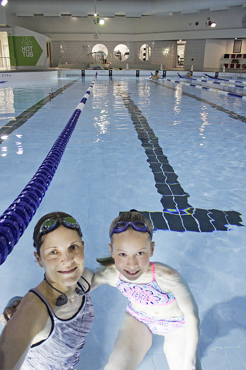 Tanya Lightbody and daughter Danielle Hagyard were among the first to swim in the W.C. Blair pool when the renovated facility re-opened Sunday morning.                                 Dan Ferguson Langley Times