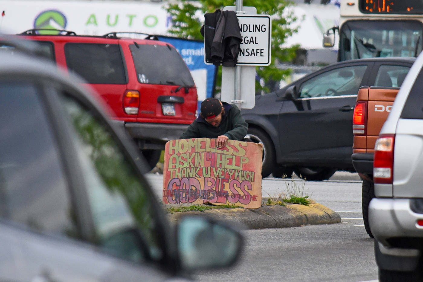 B.C. city to fine those who give cash to panhandlers, buskers