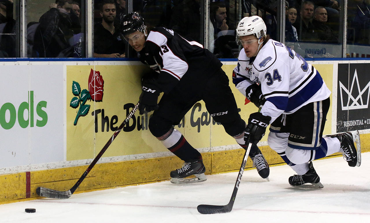 Giants forward Tyler Popowich and Royals' Kaid Oliver pursue a loose puck. Jon Howe Victoria Royals