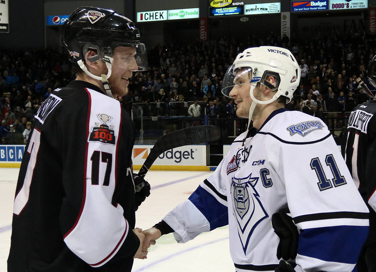 Captains Tyler Benson and Matthew Phillips shake hands following the Victoria Royals 4-3 game seven victory in the WHL playoffs. Jon Howe Victoria Royals