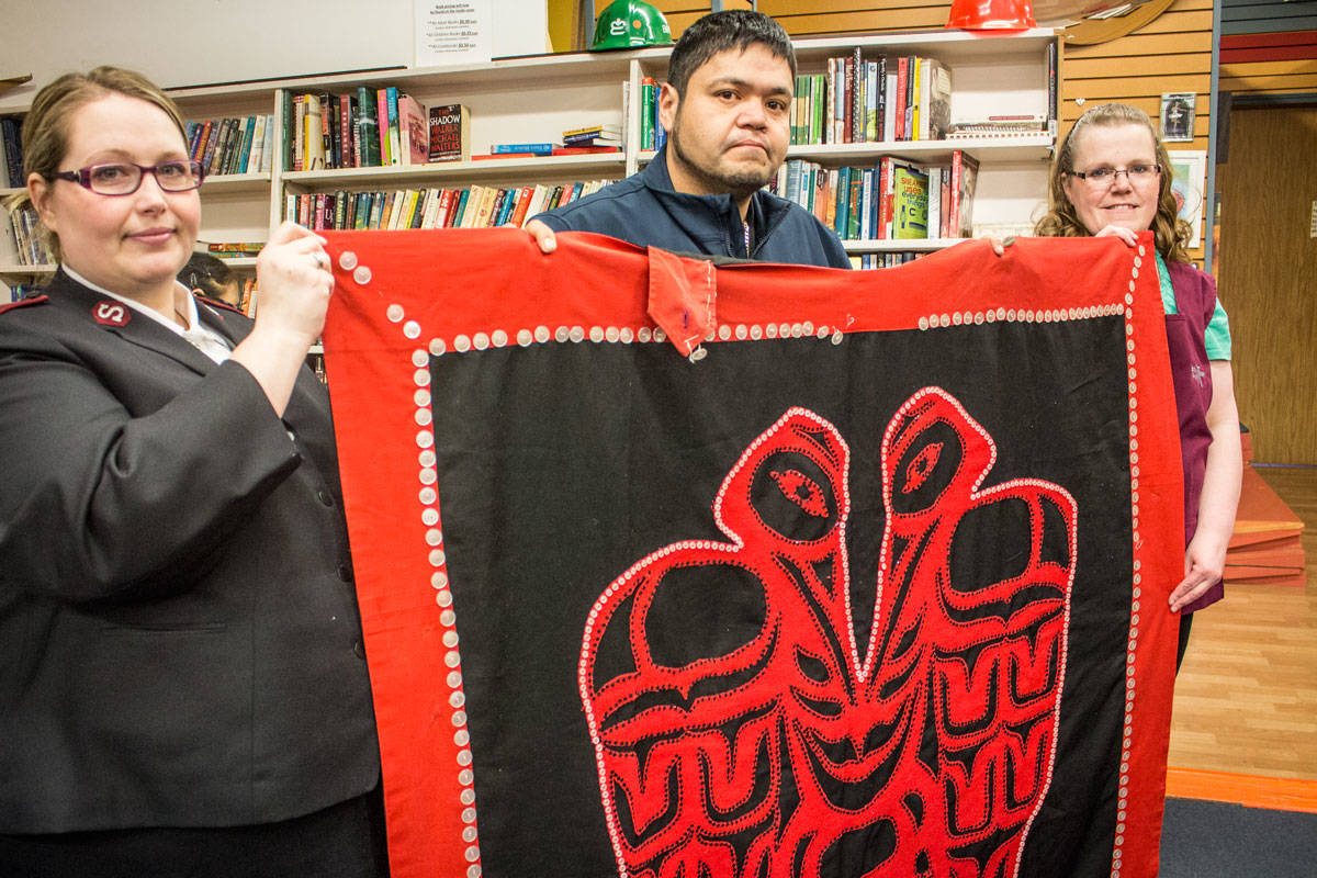 A heartfelt reunion, as Lt. Sabrina Silvey and Roma Dawe of the Prince Rupert Salvation Army give Oliver Stewart his mother's long-lost, handmade regalia. (Keili Bartlett / The Northern View)