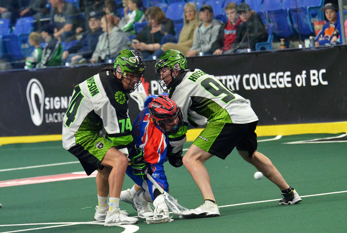 Vancouver Stealth's Brendan Fowler is sandwiched in between Saskatchewan Rush's Jeremy Thompson and Matt Hossack during NLL action at the Langley Events Centre on April 13. Gary Ahuja Langley Times