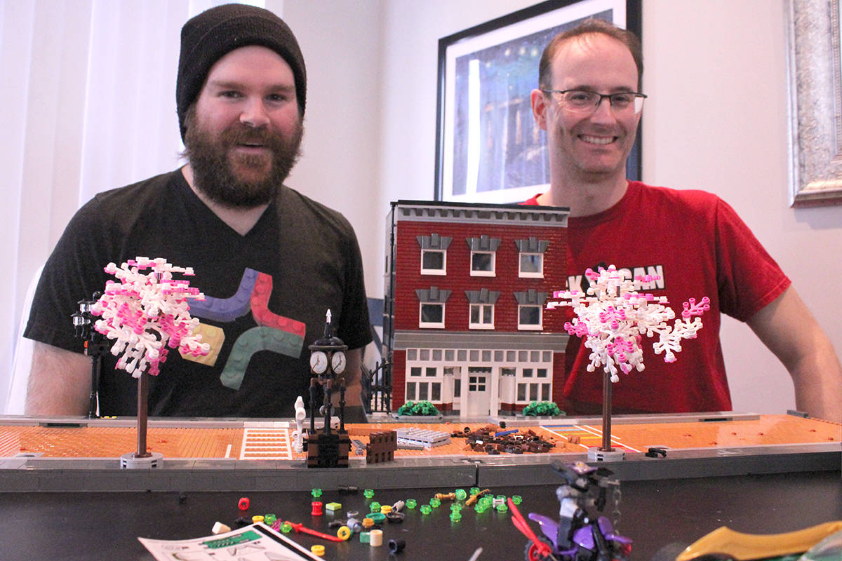 David Guedes and Allan Corbeil sit with components of their Memory Lane creation. (Samantha Anderson)