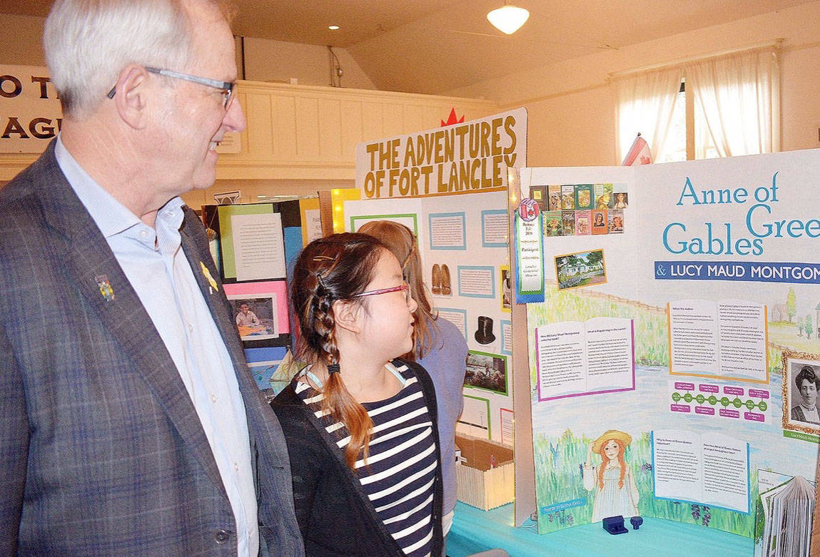 Elisha Kwon, a Grade 5 student at Lynn Fripps Elementary, showed her Anne of Green Gables project to Township of Langley Mayor Jack Froese during the third annual Heritage Fair. Submitted photo