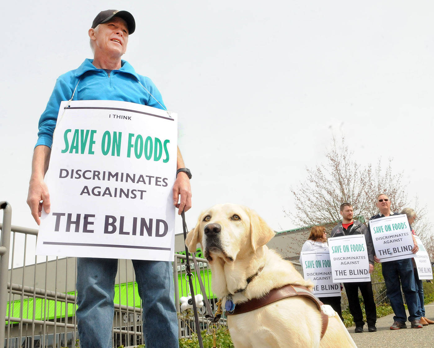Joined by his service dog Gretel and a handful of supporters, Matt Salli picketed outside the Walnut Grove Save-On-Foods location Thursday afternoon. Troy Landreville Langley Times