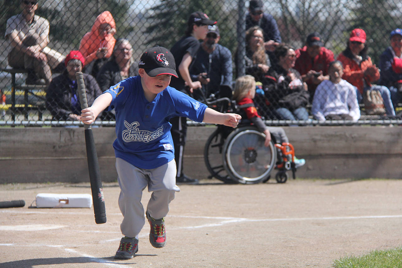One of the players runs to first base during the 2018 season opening game for Cloverdale's Challenger Baseball. (Grace Kennedy photo)