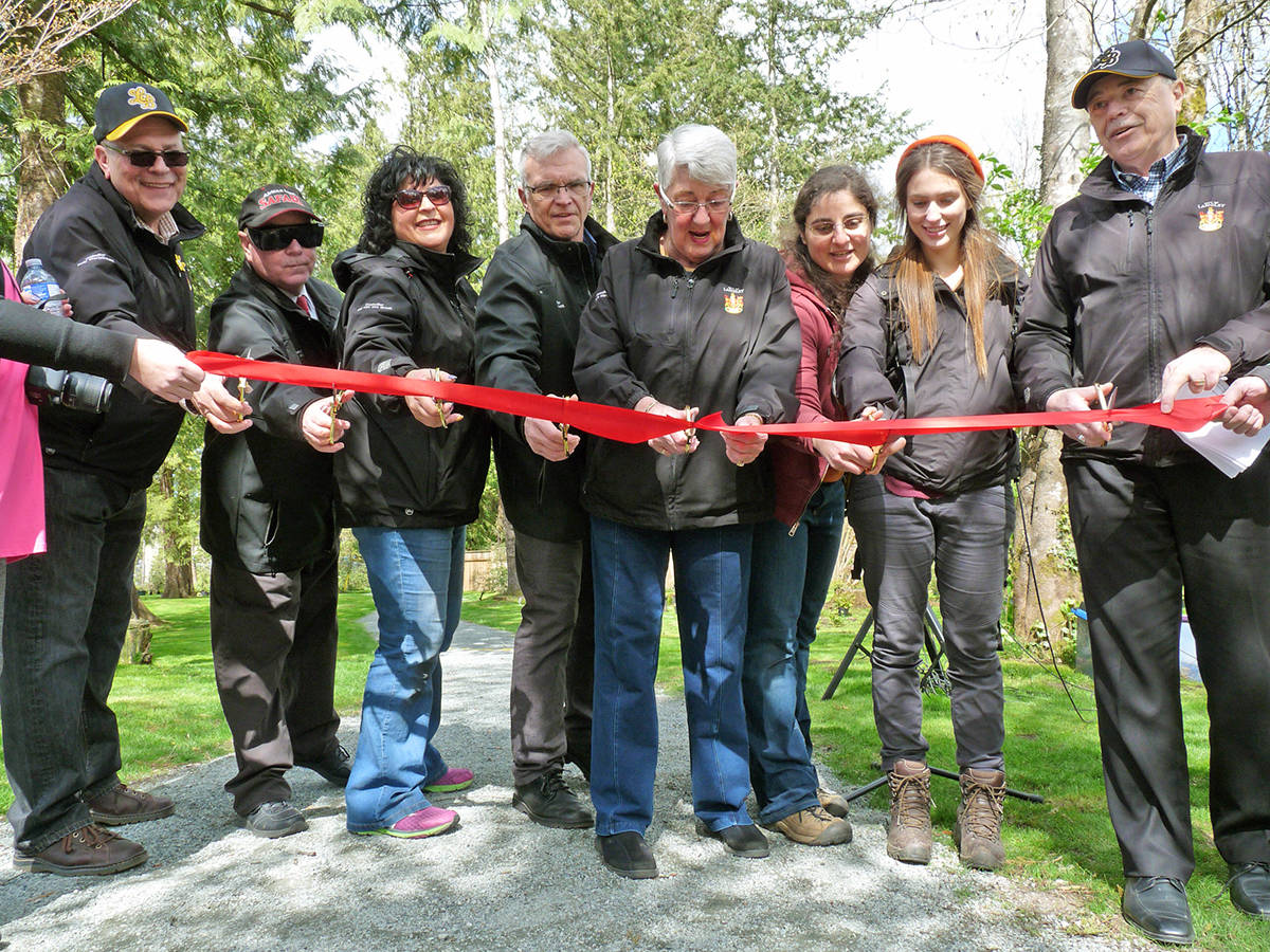 Members of Langley City Council and the Lower Mainland Green Team cut the ribbon at the official re-opening of Hunter Park. Dan Ferguson Langley Times