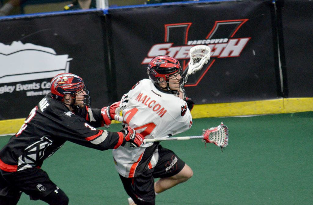 Vancouver Stealth forward Anthony Malcom gets a step on Calgary's Dan MacRae during NLL action at the Langley Events Centre on Saturday night. Gary Ahuja Langley Times