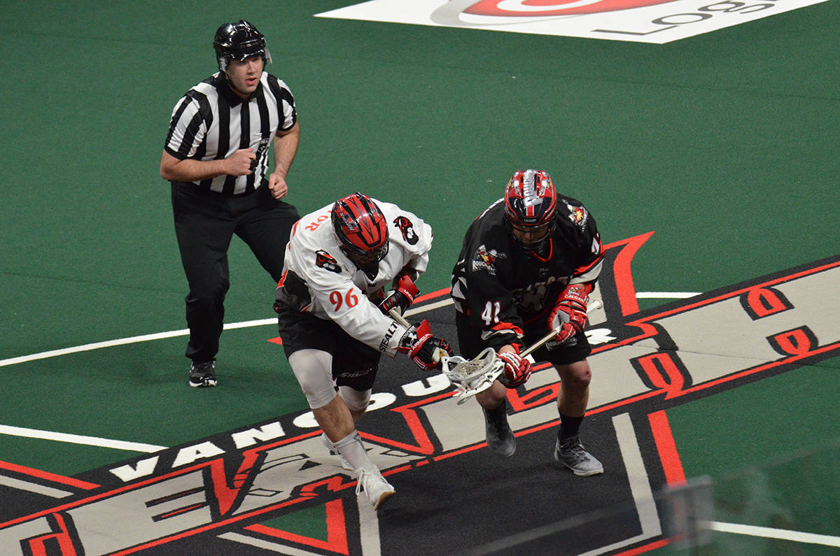 Vancouver's Andrew Suitor battles with Calgary Roughnecks' Bob Snider. Gary Ahuja Langley Times