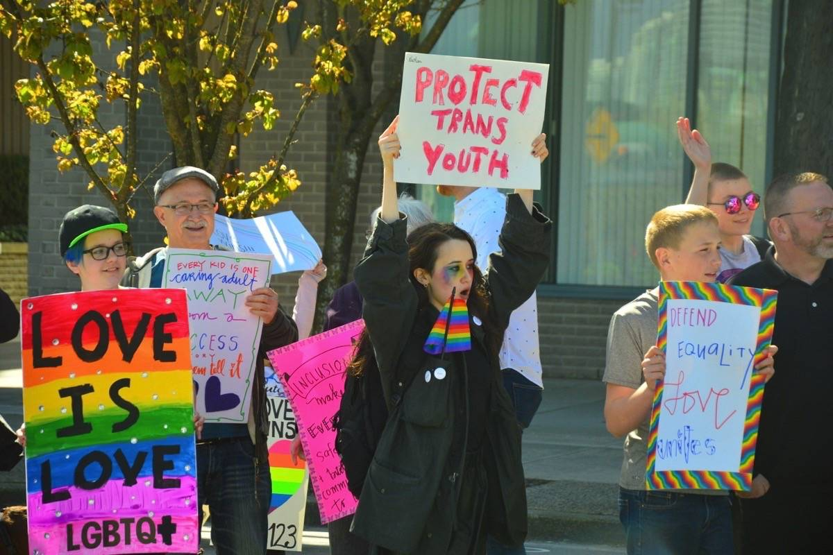Pro-SOGI supporters came out to cheer on better sex and gender identity education in B.C.'s schools on Monday. (Katya Slepian/Black Press)