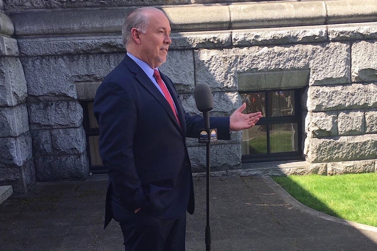 B.C. Premier John Horgan takes questions outside his legislature office, April 25, 2018. (Black Press)