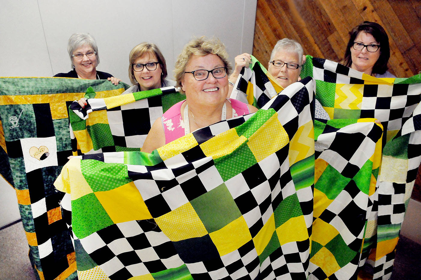 Mom of San Jose Sharks defenceman Brenden Dillon, Debbie Dillon (centre) and members of the Langley Quilters' Guild gathered April 24 to sew four 'community quilts' for the community of Humboldt.                                 Troy Landreville  Langley Times