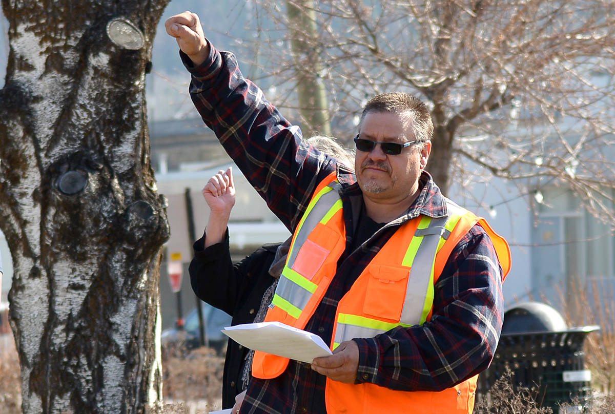 CUPE local 2093 representative Mike Poirier raises his fist as a salute to fallen workers. Phil McLachlan/The Free Press                                CUPE local 2093 representative Mike Poirier raises his fist as a salute to fallen workers. (Phil McLachlan/The Free Press)